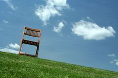 Wooden chair on a hilltop Stock Images