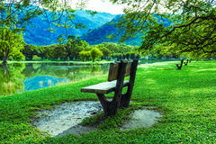 Wooden chair at lake garden Stock Images