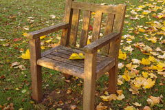 Wooden chair in the meadow Stock Photo