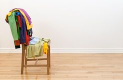 Wooden chair with messy clothes on it Royalty Free Stock Image