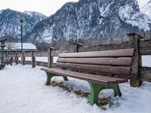 Wooden Chair outdoor in national park and mountain background. Winter season snow stock photos