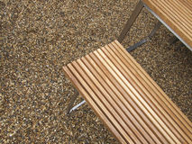 Wooden chair on the pebble floor. Close up Stock Photography