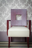 Wooden chair. Placed near a wall royalty free stock images