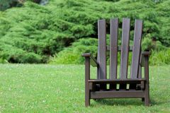 Wooden chair for relaxing in the nature. `Planten un Blomen ` city garden in Hamburg, Germany stock photography