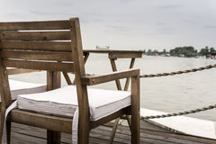 Wooden chair by the river Royalty Free Stock Photography