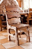 Wooden chair standing in dining room Stock Photo