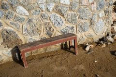 Wooden chair with Stone fence stock photography