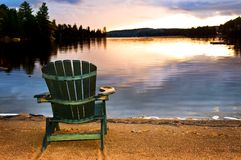 Wooden chair at sunset on beach Royalty Free Stock Photo