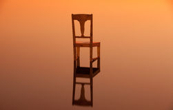 Wooden chair on the surface of a pond Stock Image
