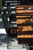 Wooden chair and table. Abstract Sunlight and shadow line on wooden chair, table and floor in dinner room Royalty Free Stock Image