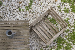 Wooden chair and table in the garden Royalty Free Stock Photos