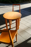 Wooden chair and table with sunlight and shadow Royalty Free Stock Photo