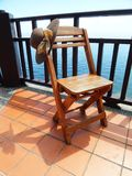 Wooden chair on the terrace Royalty Free Stock Images