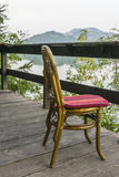 Wooden chair on the terrace Stock Photography