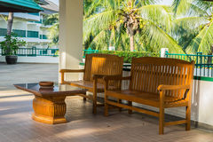 Wooden chair on terrace and sunshine Royalty Free Stock Photos