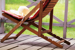 Wooden chair with women hat Royalty Free Stock Photography