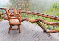 Wooden chair in wooden balcony Stock Photography