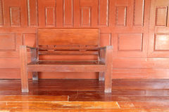 Wooden chair with wooden wall Stock Images