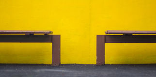 Wooden chair and yellow background in park Stock Photo