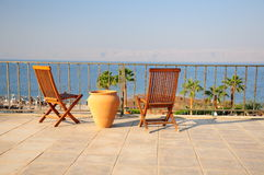 Wooden chairs. Some wooden chairs on a balcony by sea Royalty Free Stock Image