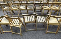 Wooden chairs. Rows of chairs in a visual spectacle Stock Photography