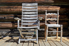 Wooden chairs. Two chairs in wood on the balcony royalty free stock images