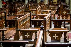 Wooden chairs adorned with crosses inside the Hanging Church in Cairo royalty free stock images