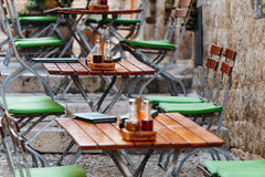 Free Wooden Chairs And Tables With A Menu, Salt And Oil In A European Street Cafe Or Restaurant Stock Images - 91240234