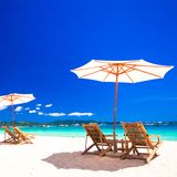 Wooden Chairs And Umbrellas On White Sand Beach Royalty Free Stock Images