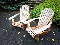 Wooden chairs in autumn garden Royalty Free Stock Image