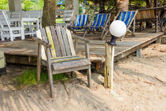 Wooden chairs on the beach Royalty Free Stock Images