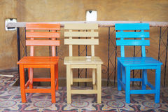Wooden chairs on ceramic tiles floor Royalty Free Stock Photography