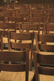 Wooden chairs in a church Stock Photo
