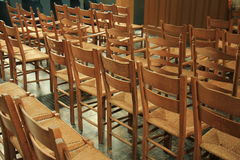 Wooden chairs in a church Stock Images