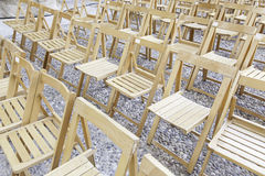 Wooden chairs in a concert Royalty Free Stock Photo