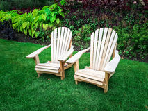 Wooden chairs on green lawn Stock Photo