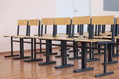 Wooden chairs in the hall Stock Photography