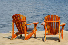 Wooden chairs lakeside Stock Image