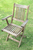 Wooden chairs on the lawn stock photo