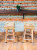 Wooden chairs with leather seat against red brick wall in coffee. The empty cafe Coffee shop, wooden chairs with leather seat near the bar against red/orange Stock Images
