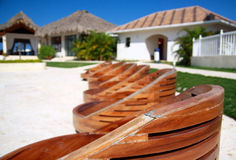 Wooden chairs near swimming pool Royalty Free Stock Images