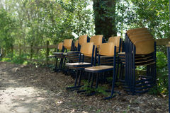 Wooden chairs outside in spring for cleaning Stock Photography