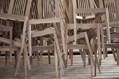Wooden Chairs Piled Up. Unifinished Wooden Chairs Piled Up Stock Photography
