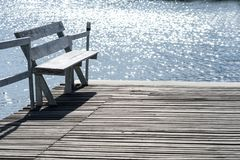 Wooden chairs and pond for relax time at home. Concept interior at home Royalty Free Stock Image