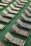 Wooden chairs on pool Royalty Free Stock Image