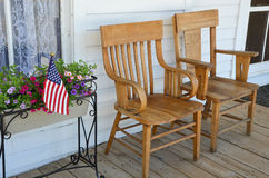 Wooden chairs on porch Royalty Free Stock Images