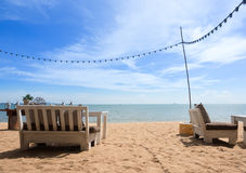 Wooden Chairs and table relax time on the beach Stock Photo