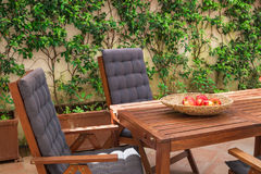 Wooden chairs and table for relaxation. stock photos