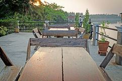 Wooden chairs and tables in garden restaurant Royalty Free Stock Images