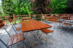 Wooden chairs and tables in park cafe Stock Photo